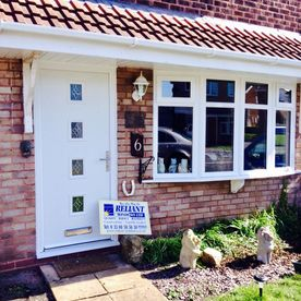 White double glazed entrance door and front of house windows